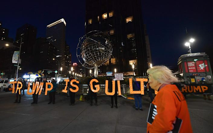 A man dressed as Trump in a prison jump suit protests in front of Trump International Hotel & Tower on January 06, 2021 in New York City - Angela Weiss/AFP