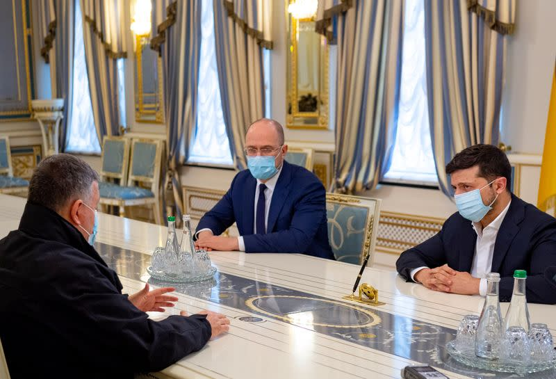 Ukrainian President Zelenskiy, Prime Minister Shmygal and Interior Minister Avakov discuss a recent armed conflict during a meeting in Kiev