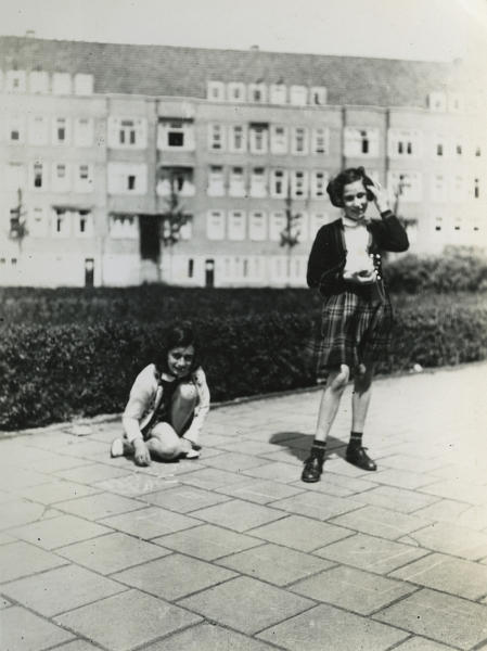 In this May 1941 photo provided by the Anne Frank House Amsterdam on Tuesday, Feb. 4, 2014, Anne Frank, left, plays with her friend Hanneli Goslar, right, on the Merwedeplein square in Amsterdam. Shortly before Anne Frank and her family went into hiding from the Nazis, she gave away some of her toys to non-Jewish neighborhood girlfriend Toosje Kupers for safekeeping. The toys have now been recovered and Anne's tin of marbles will go on display for the first time this week at an art gallery in Rotterdam, the Anne Frank House Museum says. (AP Photo/Anne Frank House Amsterdam/Anne Frank Fonds Basel photo collections)