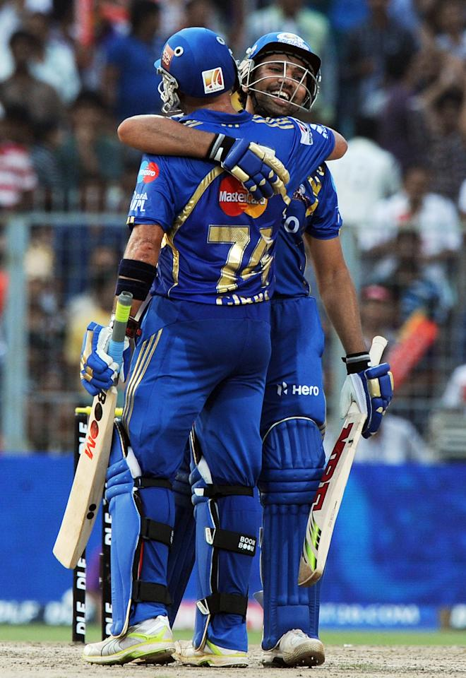 Mumbai Indians batsman Herschelle Gibbs (L) congratulates teammate Rohit Sharma for his century (100 runs) during the IPL Twenty20 cricket match between Kolkata Knight Riders and Mumbai Indians at The Eden Gardens in Kolkata on May 12, 2012.  RESTRICTED TO EDITORIAL USE. MOBILE USE WITHIN NEWS PACKAGE.  AFP PHOTO/Dibyangshu SARKAR        (Photo credit should read DIBYANGSHU SARKAR/AFP/GettyImages)
