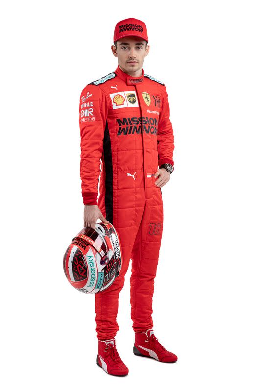 Ferrari's driver Charles Leclerc poses for a photo