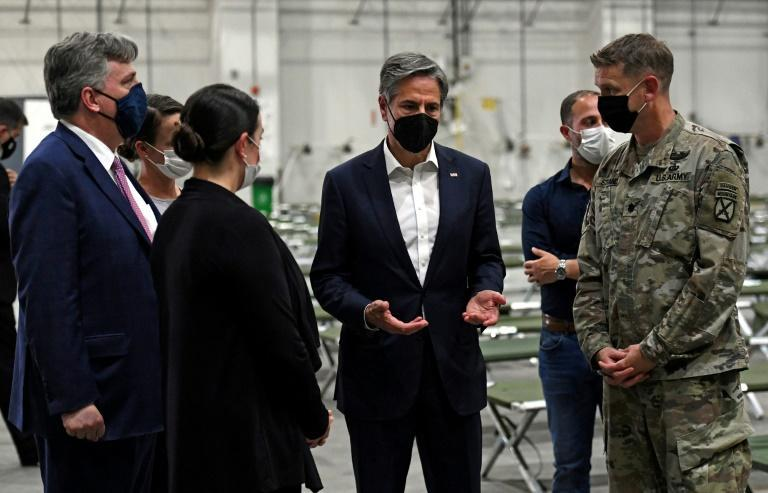 US Secretary of State Antony Blinken tours a processing centre for Afghan refugees at Al Udeid Air Base in the Qatari capital Doha (AFP/Olivier DOULIERY)