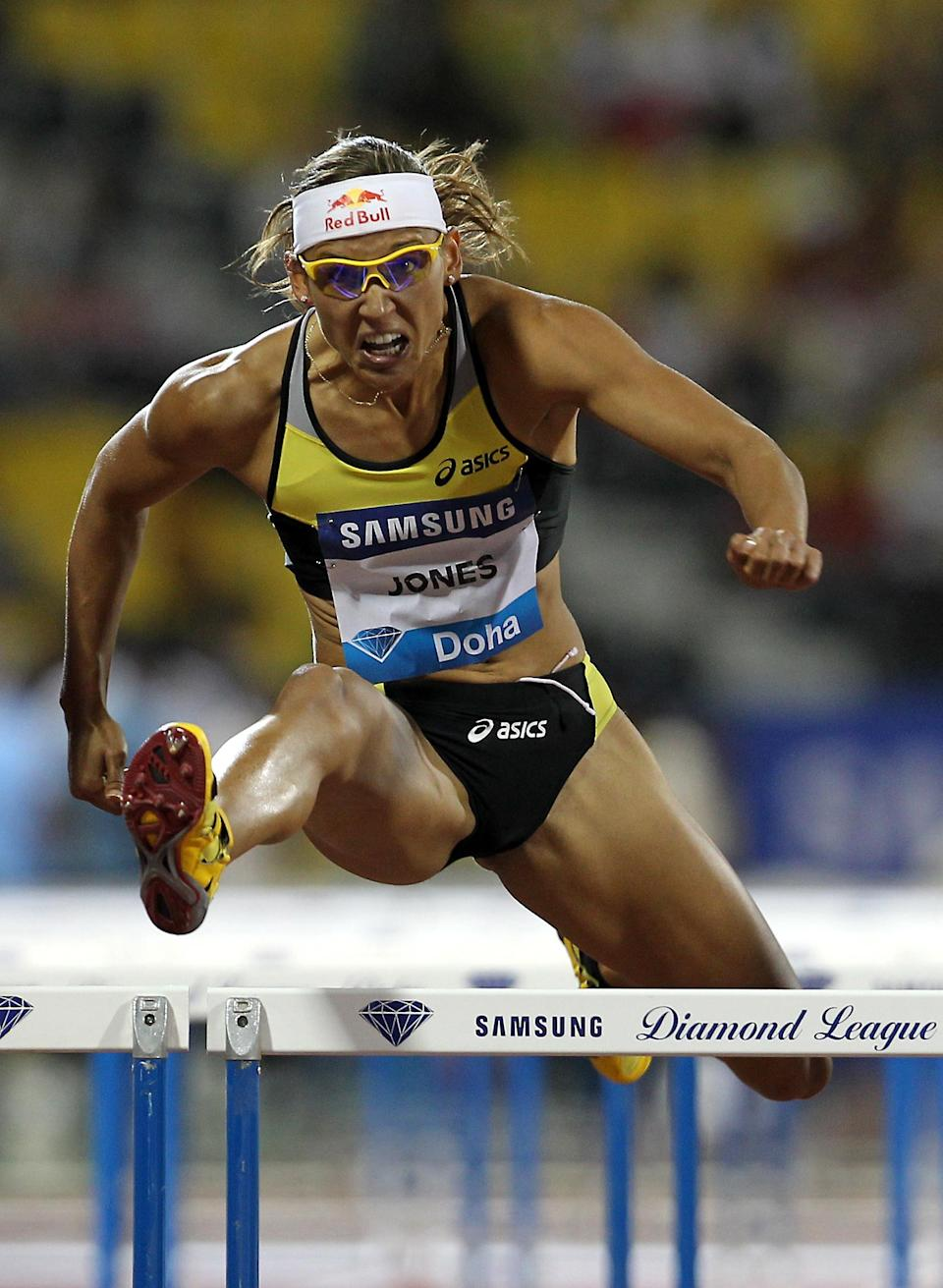 Lolo Jones of the US competes in the women's 100m hurdles at the IAAF Diamond League in Doha on May 6, 2011. (KARIM JAAFAR/AFP/Getty Images)