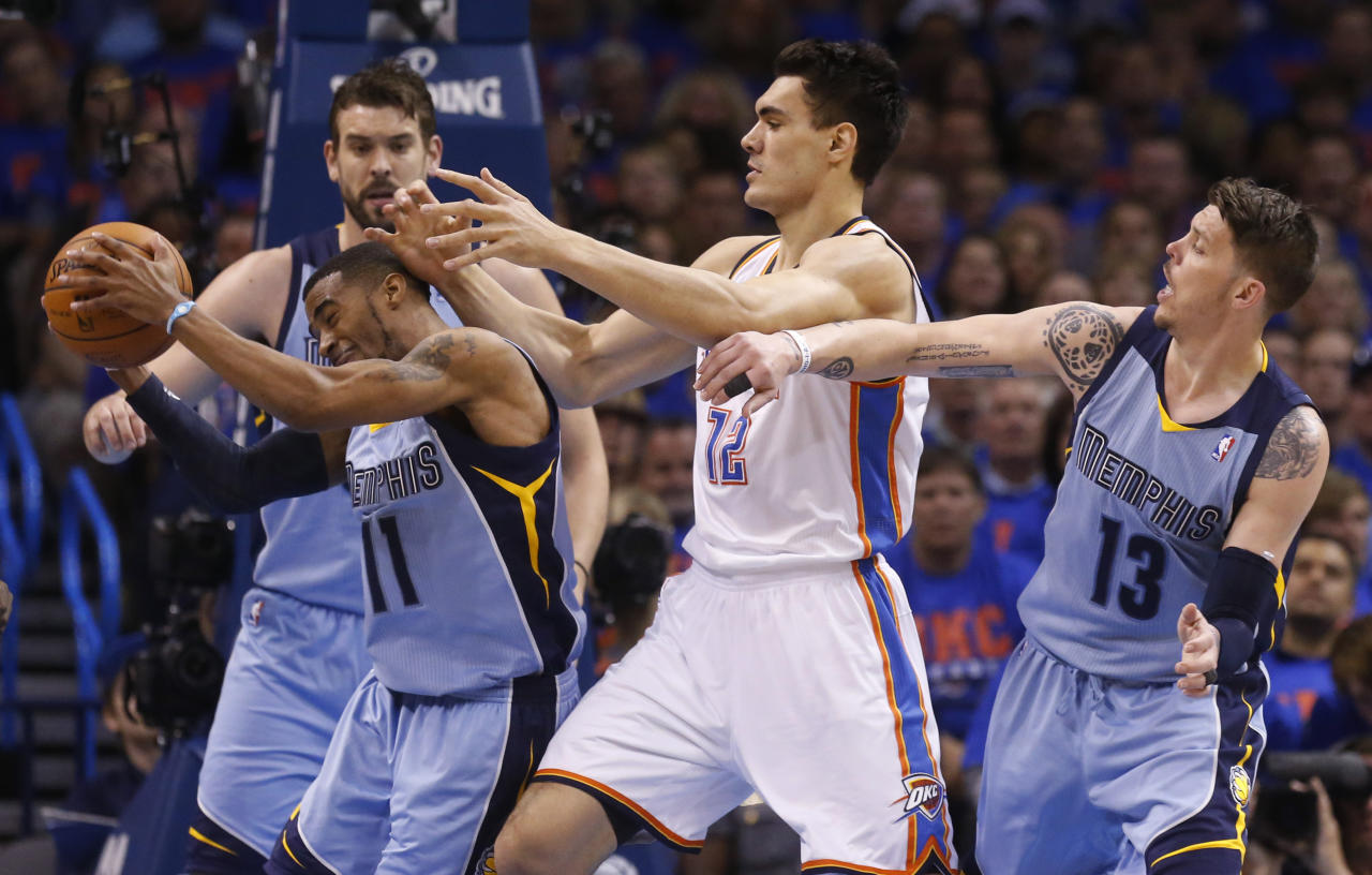 Memphis Grizzlies guard Mike Conley (11) grabs the ball in front of Oklahoma City Thunder center Steven Adams (12) and teammate Mike Miller (13) in the first quarter of Game 7 of an opening-round NBA basketball playoff series in Oklahoma City, Saturday, May 3, 2014. (AP Photo/Sue Ogrocki)