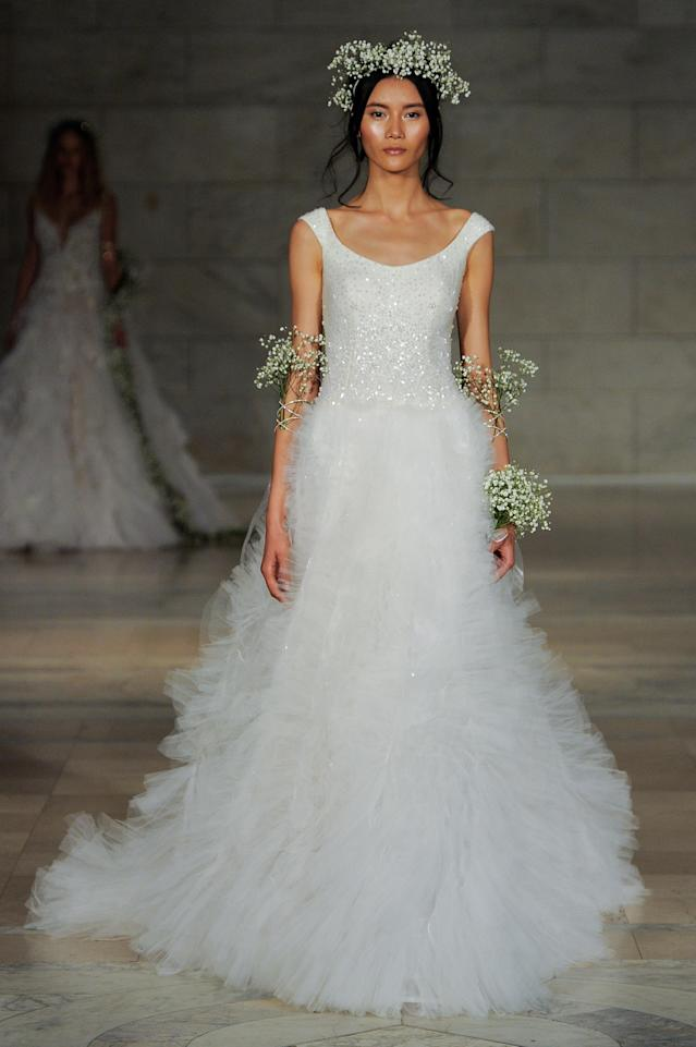 <p>Scoop-necked gown with a sequined top and tulle skirt. (Photo: Maria Valentino) </p>