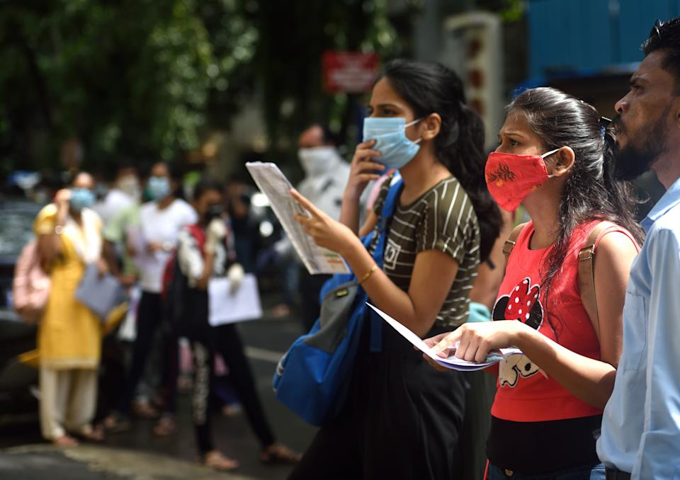 NEET 2020 aspirants stand in a queue outside the exam center at Khar, on September 13, 2020 in Mumbai. (Photo: Hindustan Times via Getty Images)