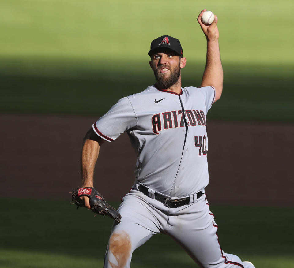 Arizona Diamondbacks starting pitcher Madison Bumgarner delivers during the sixth inning of the second game of a double header against the Atlanta Braves Sunday, April 25, 2021, in Atlanta. (Curtis Compton/Atlanta Journal-Constitution via AP)