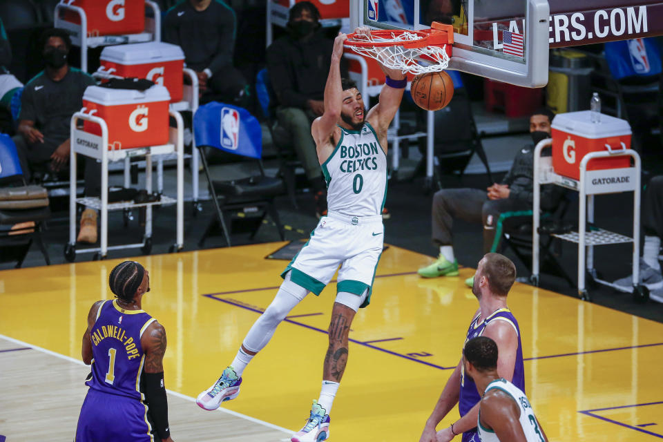 Boston Celtics' Jayson Tatum (0) dunks against the Los Angeles Lakers during the second half of an NBA basketball game Thursday, April 15, 2021, in Los Angeles. (AP Photo/Ringo H.W. Chiu)