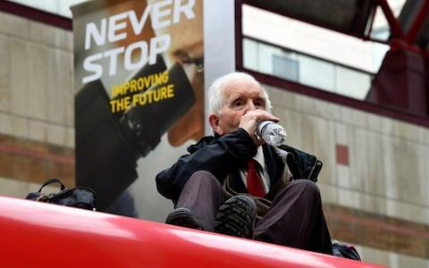 Phil Kingston, 83, said he was demonstrating over concerns for his grandchildren - Credit: Dylan Martinez/Reuters