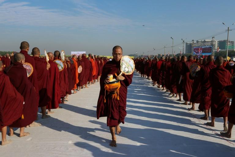 Buddhist monks from Myanmar and Thailand and senior religious officials from a dozen countries collected alms next to an airport in the central city of Mandalay (AFP Photo/KYAW ZAY WIN)