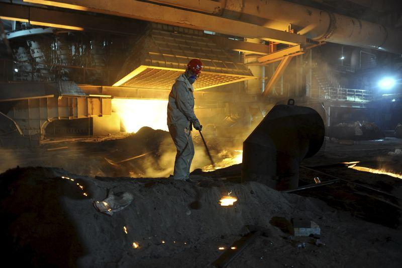 An employee works inside a steel factory in Kashgar, Xinjiang Uighur Autonomous Region, China