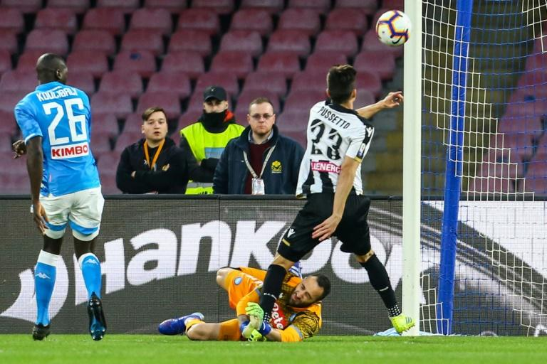 Napoli's Colombian goalkeeper David Ospina (bottom) collides with Udinese's Argentine forward Ignacio Pussetto