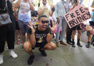 """Britney Spears supporter Brian Molina of Los Angeles celebrates outside the Stanley Mosk Courthouse, Wednesday, Sept. 29, 2021, in Los Angeles. A judge on Wednesday suspended Britney Spears' father from the conservatorship that has controlled the singer's life and money for 13 years, saying the arrangement """"reflects a toxic environment."""" (AP Photo/Chris Pizzello)"""