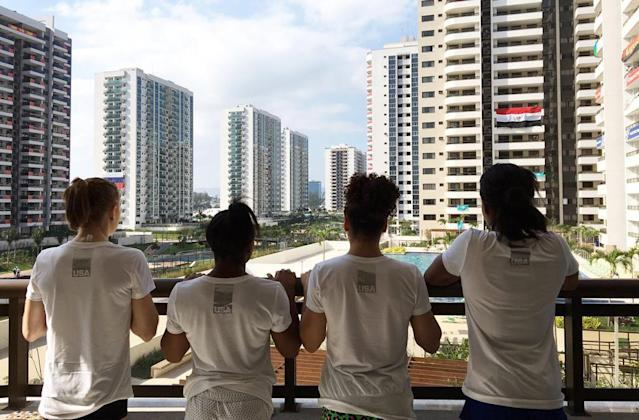 """<p>""""Embrace the journey,"""" wrote Biles on this photo of her looking out over the Olympic Village with Madison Kocian (left), Laurie Hernandez (second right), and Gabby Douglas (right). (@Simone_Biles/Twitter) </p>"""