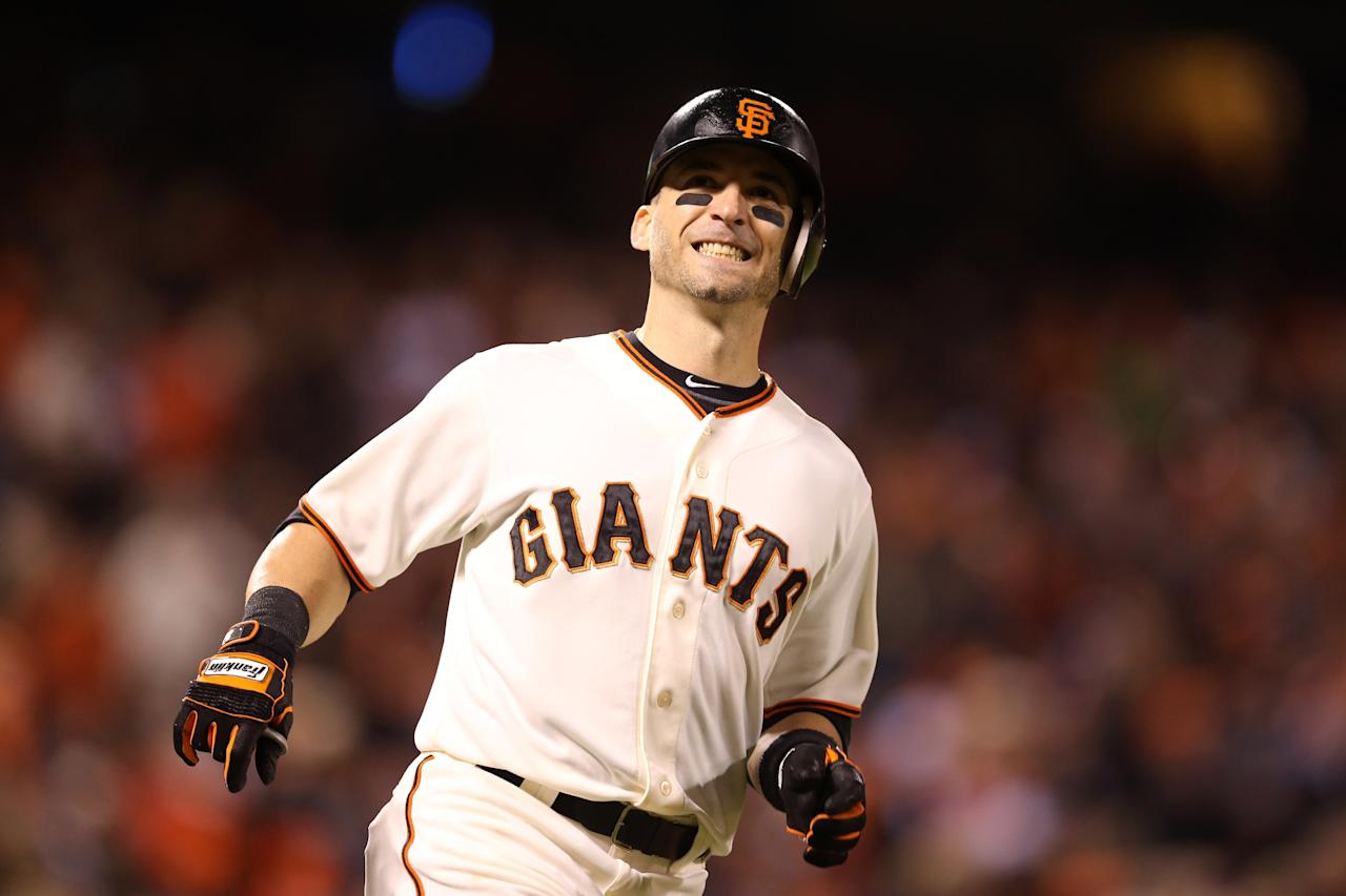 SAN FRANCISCO, CA - OCTOBER 22:  Marco Scutaro #19 of the San Francisco Giants reacts after flying out to left field in the sixth inning against the St. Louis Cardinals in Game Seven of the National League Championship Series at AT&T Park on October 22, 2012 in San Francisco, California.  (Photo by Christian Petersen/Getty Images)