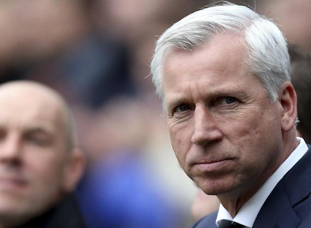 FILE - This is a Feb. 23, 2014 file photo of Newcastle United's manager Alan Pardew as he looks on ahead of their English Premier League soccer match against Aston Villa at St James' Park, Newcastle, England. The new English Premier League season starts on Saturday Aug. 16, 2014. (AP Photo/Scott Heppell, File)