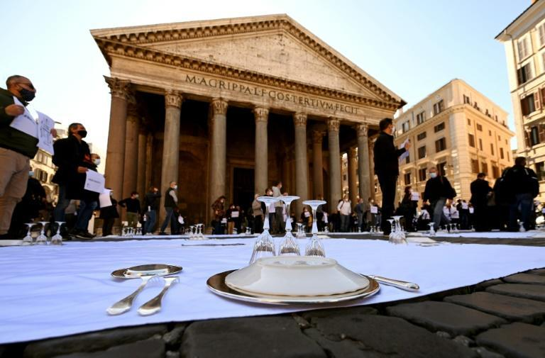 Restaurant owners laid out place settings on the street in front of the Pantheon as part of a protest against coronavirus closures