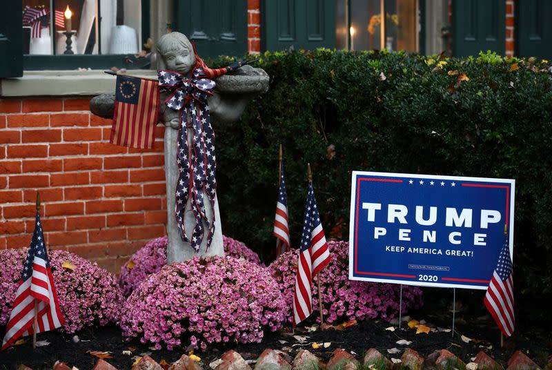 A yard sign supporting U.S President Donald Trump stands outside a house in Lancaster, Pennsylvania