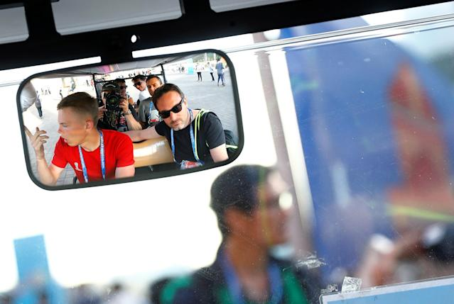 Reuters photographers (R-L) Christian Hartmann, Albert Gea, Maxim Shemetov, Carl Recine, Kai Pfaffenbach and a volunteer are reflected in the mirror of a golf cart used as a media shuttle from the Media Centre at Spartak stadium after the match between Argentina and Iceland in Moscow, Russia, June 16, 2018. As well as shooting all the matches, Reuters photographers are producing pictures showing their own quirky view from the sidelines of the World Cup. REUTERS/Kai Pfaffenbach