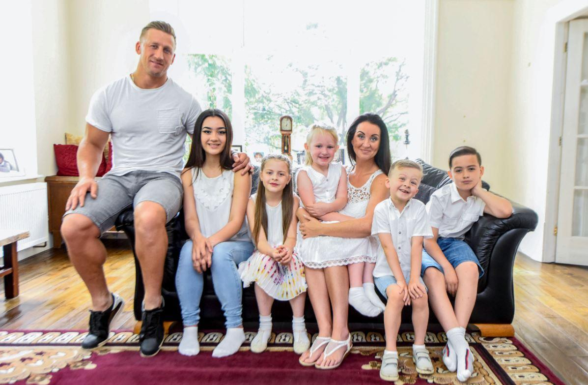 The couple pictured with Riona's four children and Keith's daughter Kalani, five (Caters)