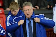 Chelsea's interim manager Guus Hiddink arrives for the English Premier League football match between Manchester United and Chelsea at Old Trafford on December 28, 2015 (AFP Photo/Oli Scarff)