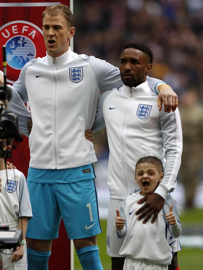 Defoe walked out with England mascot Bradley Lowrey (Getty)
