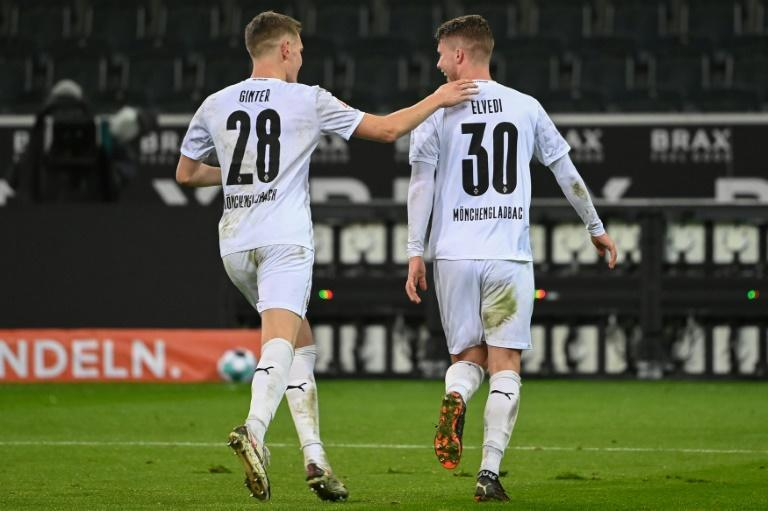 Swiss defender Nico Elvedi (R) celebrates scoring Moenchengladbach's winning goal at home to Werder Bremen
