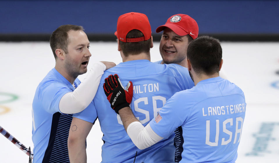 United States team jubilates after defeating Canada during the men's curling semi-final match at the 2018 Winter Olympics in Gangneung, South Korea, Thursday, Feb. 22, 2018. United States won. (AP Photo/Aaron Favila)