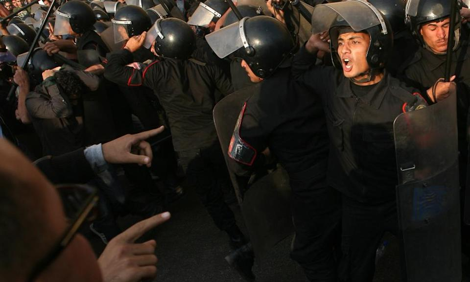 Egyptian riot police confront protesters during a demonstration in Cairo on 25 January 2011.
