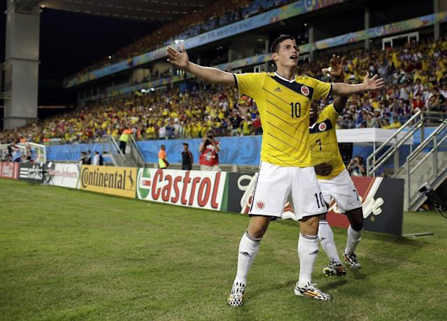 Colombia's James Rodriguez celebrates after scoring during the group C World Cup soccer match between Japan and Colombia at the Arena Pantanal in Cuiaba, Brazil, Tuesday, June 24, 2014. (AP Photo/Felipe Dana)