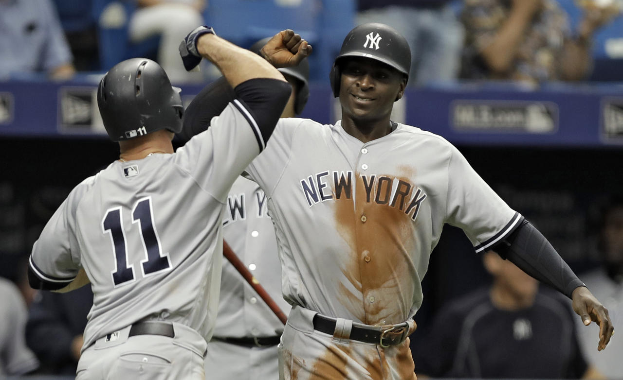 New York Yankees' Brett Gardner (11) celebrates with Didi Gregorius after Gardner hit a two-run home run off Tampa Bay Rays starting pitcher Chris Archer during the second inning of a baseball game, Sunday, May 21, 2017, in St. Petersburg, Fla. (AP Photo/Chris O'Meara)
