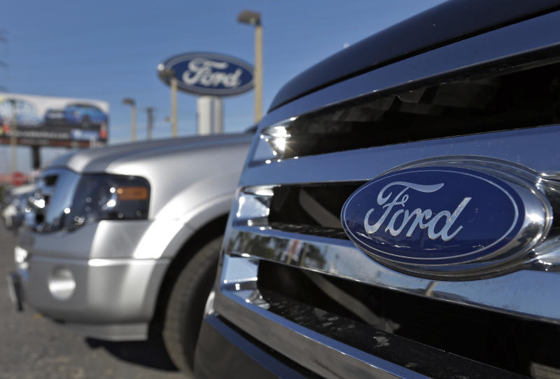 In this Monday, Nov. 19, 2012, photo, the front grill of a new Ford Explorer is seen at a dealership, in Clearwater, Fla. GE  announced Tuesday, Nov. 20, 2012, that it is buying 2,000 plug-in hybrid cars from Ford for its corporate fleet. (AP Photo/Chris O'Meara)