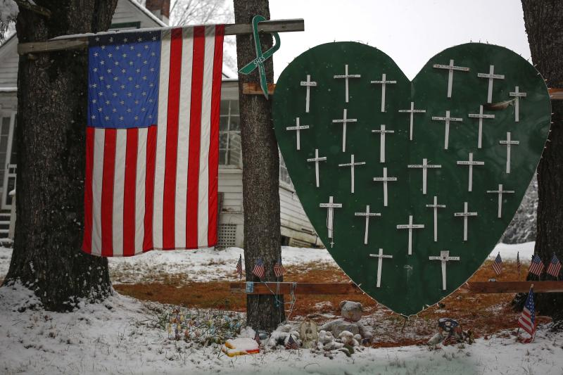 A memorial honoring the victims killed in the Sandy Hook Elementary School shooting is seen outside a home in Sandy Hook, Connecticut