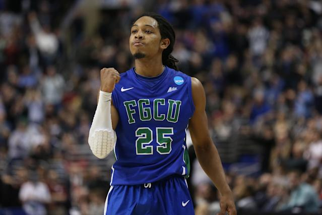 Sherwood Brown, star of Florida Gulf Coast's original Dunk City team, pumps his fist during the Georgetown upset. (Getty)