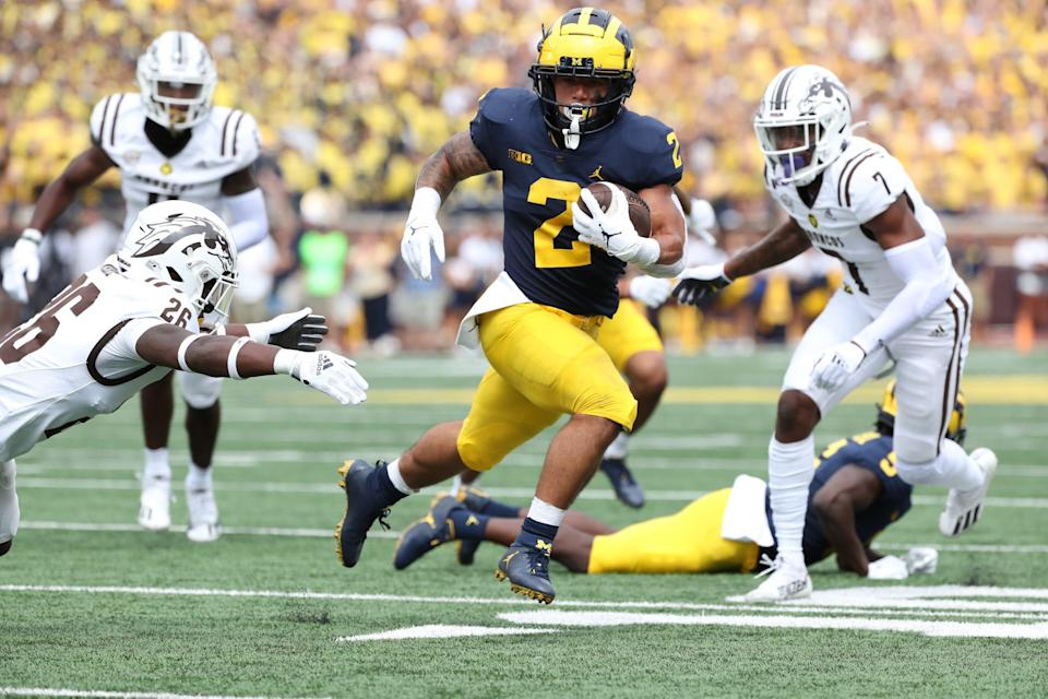 Michigan running back Blake Corum runs for a touchdown against Western Michigan during the first half in Ann Arbor on Saturday, Sept. 4, 2021.