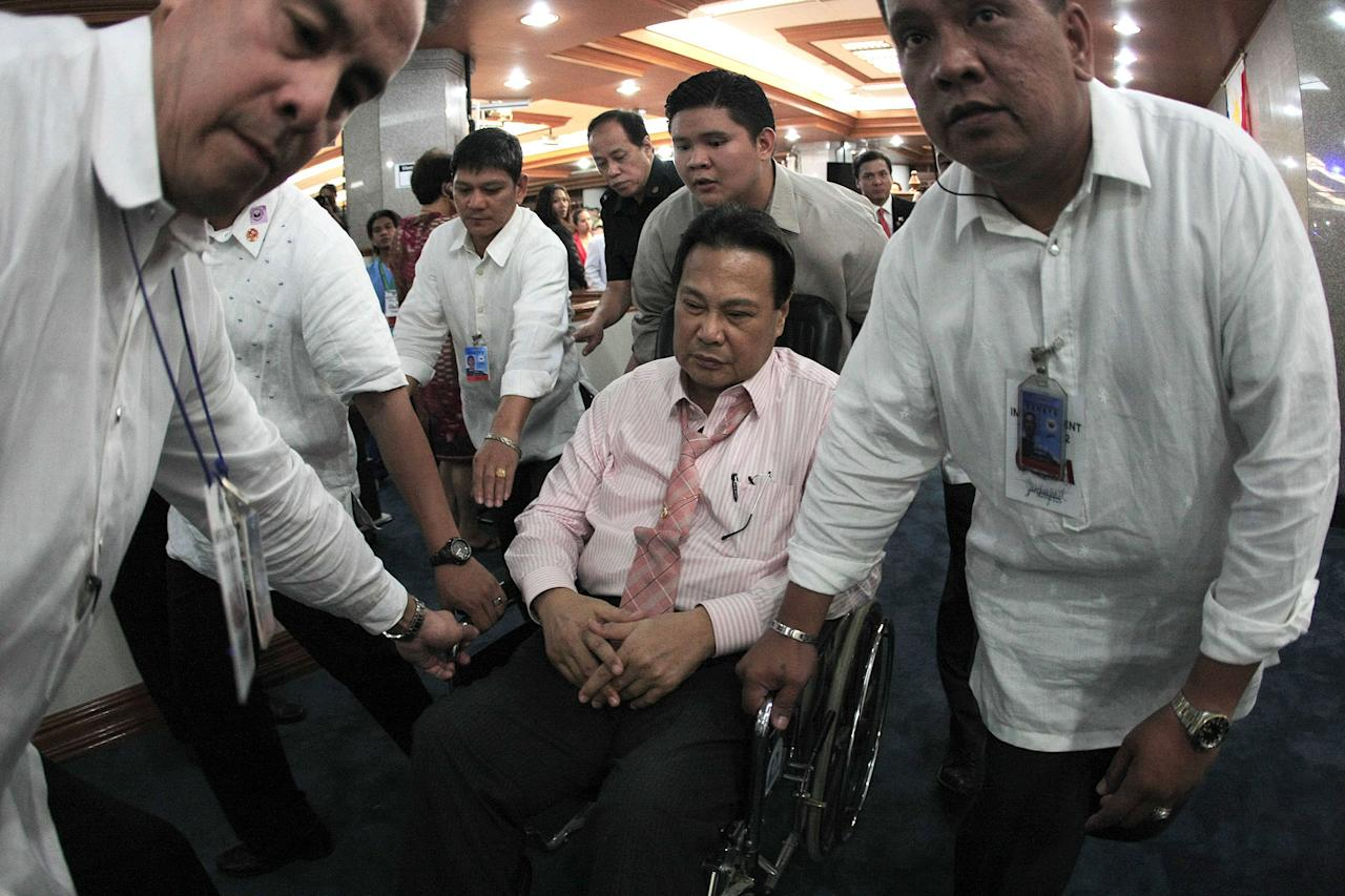 "Chief Justice on wheels: Chief Justice Renato Corona returns to the session hall in a wheelchair. (NPPA Images)<br><br><a target=""_blank"" href=""http://ph.news.yahoo.com/corona-to-impeachment-court--i-am-innocent.html"">Story: Corona 'walks out'</a>"