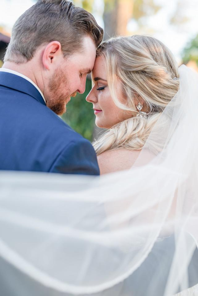 """<p>Nathan proposed to Dana at Disneyland, which encouraged them to include sweet and magical touches to their special day in Mesa, AZ. <a href=""""https://www.popsugar.com/love/outdoor-disney-themed-wedding-ideas-46947870"""" class=""""ga-track"""" data-ga-category=""""Related"""" data-ga-label=""""https://www.popsugar.com/love/outdoor-disney-themed-wedding-ideas-46947870"""" data-ga-action=""""In-Line Links"""">See the wedding here!</a></p>"""