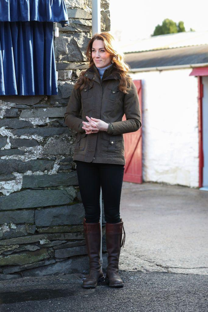 "<p>The Duchess traveled to <a href=""https://www.townandcountrymag.com/society/tradition/a30878236/kate-middleton-outfit-farm-northern-ireland-photos/"" rel=""nofollow noopener"" target=""_blank"" data-ylk=""slk:the Ark Open Farm in Northern Ireland wearing her Barbour coat"" class=""link rapid-noclick-resp"">the Ark Open Farm in Northern Ireland wearing her Barbour coat</a>, a pair of brown boots, jeans, and a turtleneck.</p>"