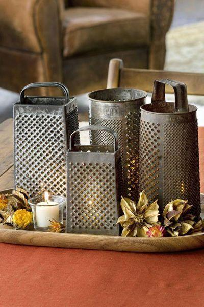 <p>There's no reason why collectibles, like salvaged shredders, shouldn't be part of your dinner table arrangement. When placed alongside votive candles, they're brilliant for adding charm to a fall table. </p>