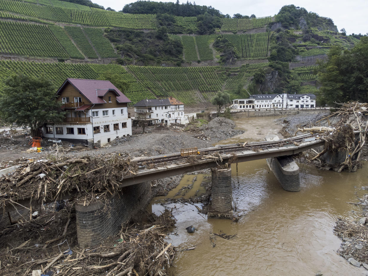 DERNAU, GERMANY - AUGUST 04: Destroyed houses, hotels and railway tracks pictured during ongoing cleanup efforts in the Ahr Valley region following catastrophic flash floods on August 04, 2021 near Dernau, Germany. Villages along the Ahr river as well as other towns and villages across western Germany are attempting to recover from devastating floods in mid-June that left at least 170 people dead, hundreds injured and approximately 70 still missing.  (Photo by Thomas Lohnes/Getty Images)