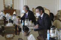 Director General of International Atomic Energy Agency, IAEA, Rafael Mariano Grossi, right, looks towards Iranian Foreign Minister Mohammad Javad Zarif during a meeting, in Tehran, Iran, Sunday, Feb. 21, 2021. The head of the United Nations' nuclear watchdog met Sunday with Iranian officials in a bid to preserve his inspectors' ability to monitor Tehran's atomic program, even as authorities said they planned to cut off surveillance cameras at those sites. (AP Photo)