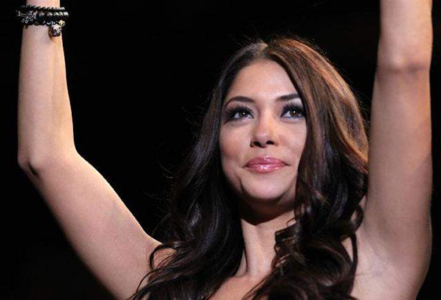 SAITAMA, JAPAN - FEBRUARY 26: UFC Octagon Girl Arianny Celeste introduces round three during the Rampage v Bader bout during the UFC 144 event at Saitama Super Arena on February 26, 2012 in Saitama, Japan.