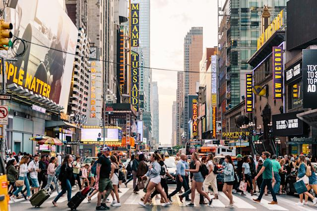 People crossing a street in New York, US. Photo: Getty
