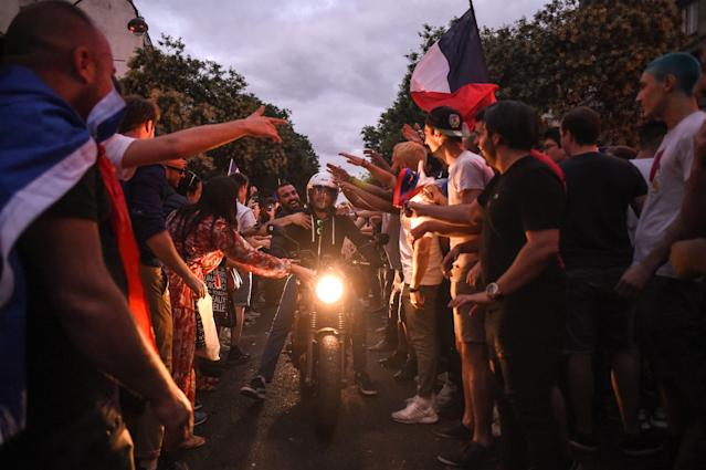 <p>People celebrate France's victory in central Paris on July 10, 2018 after the final whistle of the Russia 2018 World Cup semi-final football match between France and Belgium. (Photo by Lucas BARIOULET / AFP) </p>