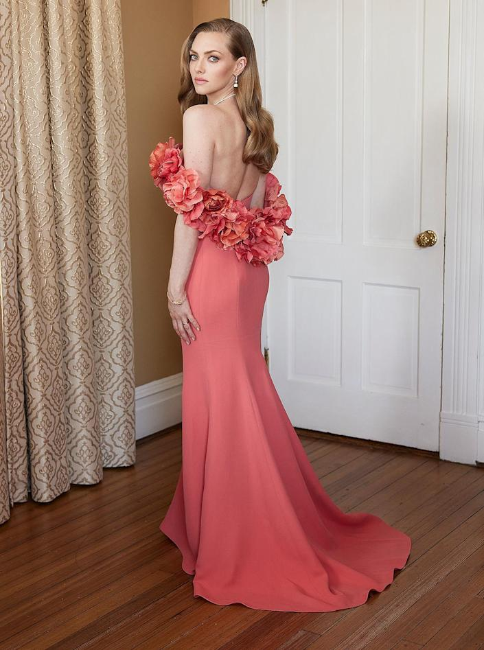 """<p>The <em>Mank</em> nominee wore a coral Oscar de la Renta gown with a floral appliqués but according to her stylist, <a href=""""https://www.instagram.com/elizabethstewart1/"""" rel=""""nofollow noopener"""" target=""""_blank"""" data-ylk=""""slk:Elizabeth Stewart"""" class=""""link rapid-noclick-resp"""">Elizabeth Stewart</a>, the off-the-shoulder look <a href=""""https://people.com/style/amanda-seyfried-dress-went-missing-before-2021-golden-globes/"""" rel=""""nofollow noopener"""" target=""""_blank"""" data-ylk=""""slk:almost didn't make it to Seyfried"""" class=""""link rapid-noclick-resp"""">almost didn't make it to Seyfried</a> (who is currently in Savannah, Georgia with her family).</p> <p>""""The dress was lost for an entire 36 hours on its way to Savannah,"""" Stewart reveals. """"Someone from Oscar de la Renta drove hours to the 24-hour FedEx hub in Newark and stayed there until they found the dress in the nick of time.""""</p>"""
