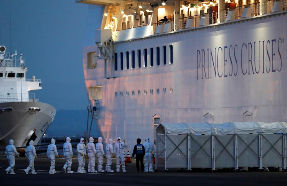 Officers in protective gear enter the cruise ship Diamond Princess, where 10 more people were tested positive for coronavirus on Thursday, to transfer a patient to the hospital after the ship arrived at Daikoku Pier Cruise Terminal in Yokohama, south of Tokyo, Japan February 7, 2020. REUTERS/Kim Kyung-Hoon REFILE - ADDING INFORMATION