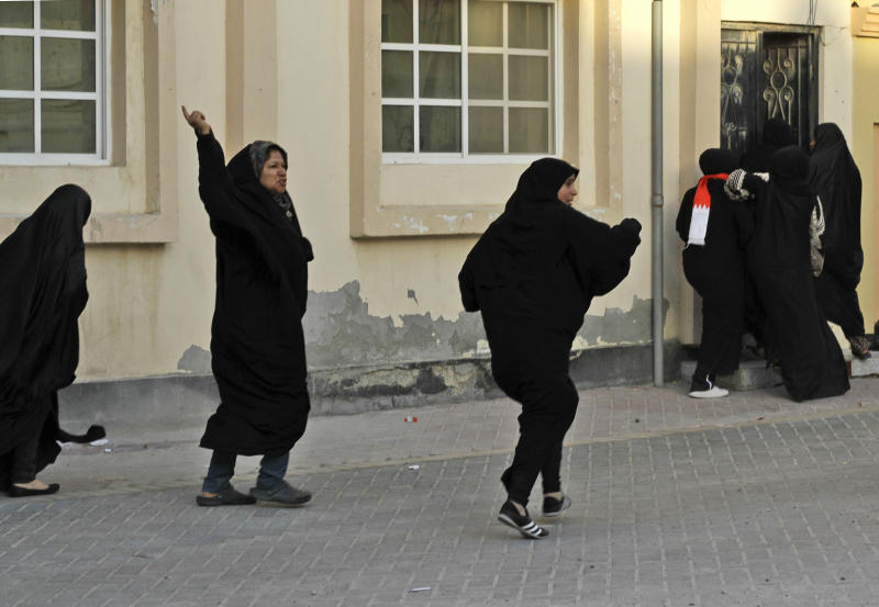Bahraini anti-government protesters run from riot police firing tear gas and stun grenades to disperse a demonstration in support of victims of torture in Buri, Bahrain, southwest of the capital of Manama, on Wednesday, June 27, 2012. Prominent Bahraini human rights activist Zainab al-Khawaja was shot in the leg with a tear gas canister and taken to a hospital by another activist. (AP Photo/Hasan Jamali)