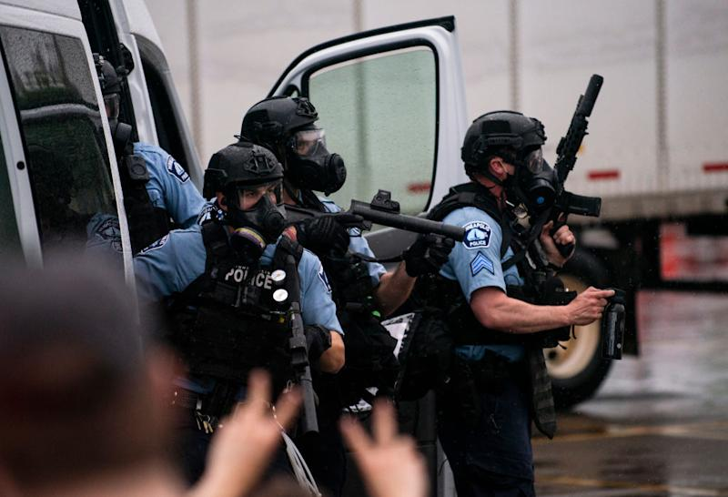 Police dressed in tactical gear attempt to disperse protesters outside the Third Precinct Police Station. Source: Getty Images