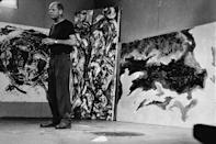"<p>On August 11, <a href=""https://www.biography.com/people/jackson-pollock-9443818"" rel=""nofollow noopener"" target=""_blank"" data-ylk=""slk:Jackson Pollock"" class=""link rapid-noclick-resp"">Jackson Pollock</a> dies in a car accident. He's shown here in his studio in 1953 with a few of his large-scale works. </p>"