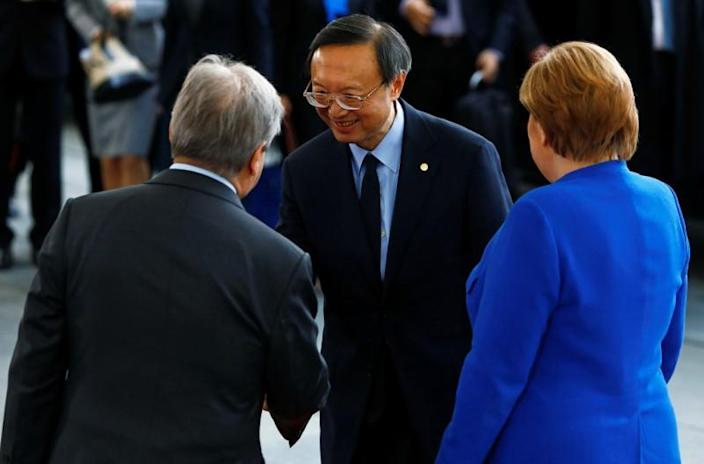 German Chancellor Angela Merkel and United Nations Secretary-General Antonio Guterres welcome Yang Jiechi, director of the Office of Foreign Affairs of the Communist Party of China, at the Libya summit in Berlin